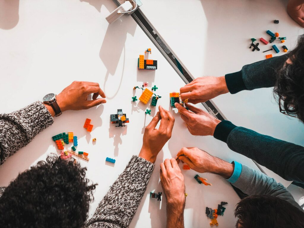 Group of people playing with colourful legos